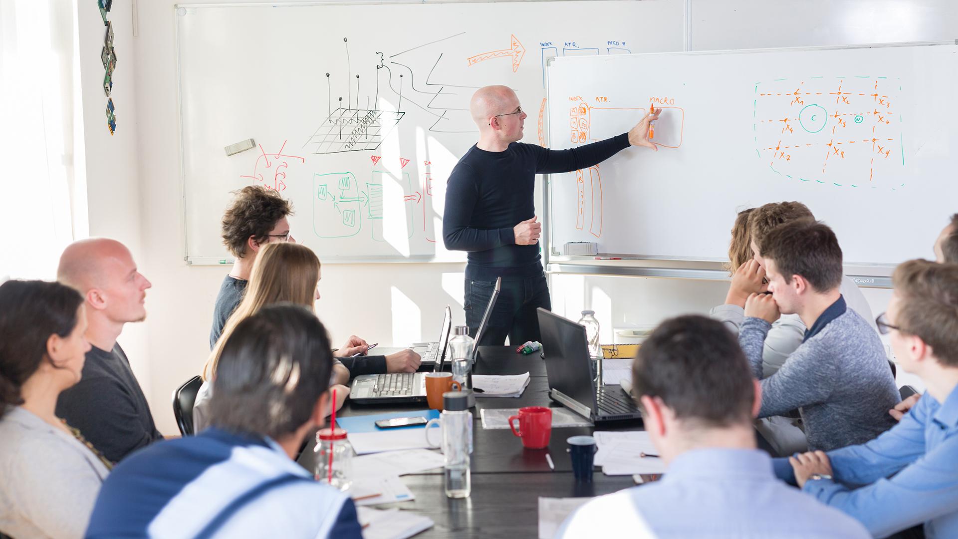 team-group-meet-whiteboard-plan-teach-strategy
